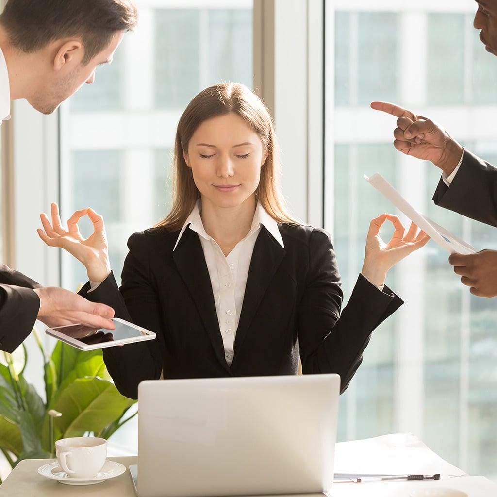 Balance - Woman meditating through work stress