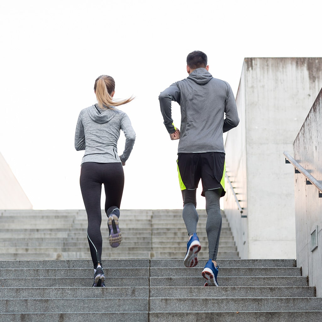 Couple Running up Stairs